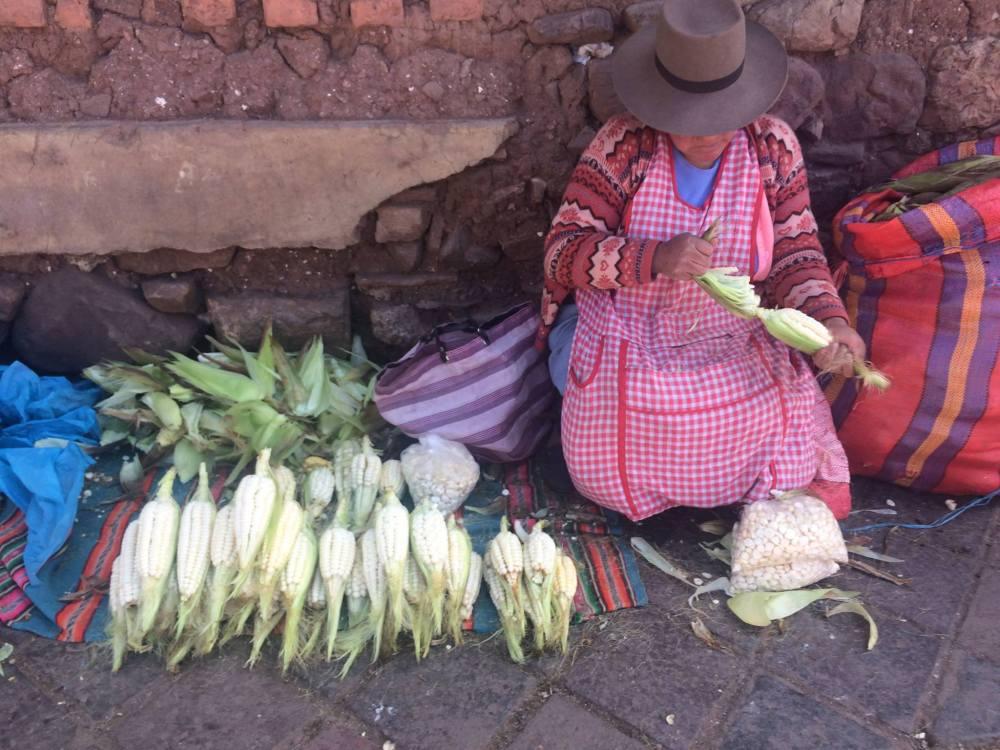 Quechua woman selling corn in one of Cusco's sidewalks
